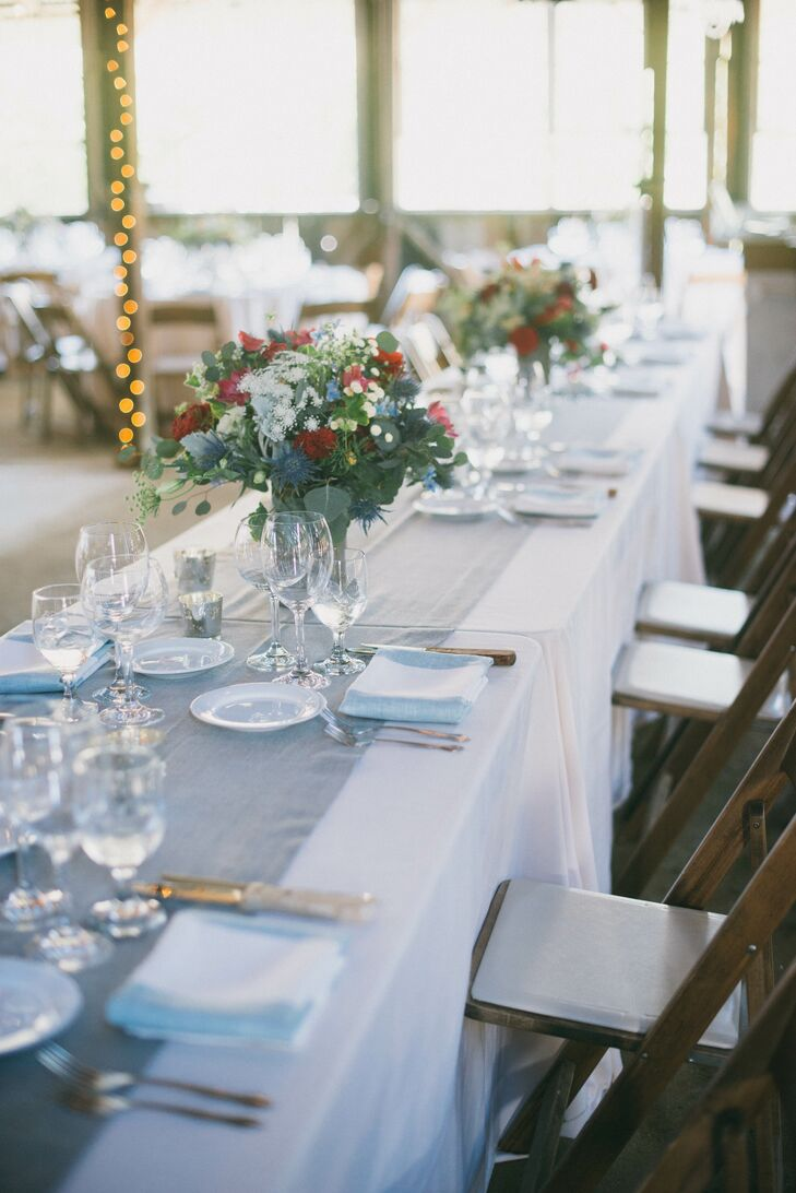 After the ceremony, the aisle's floral decorations were repurposed as table centerpieces at the reception at Dana Powers Barn in Nipomo, California.