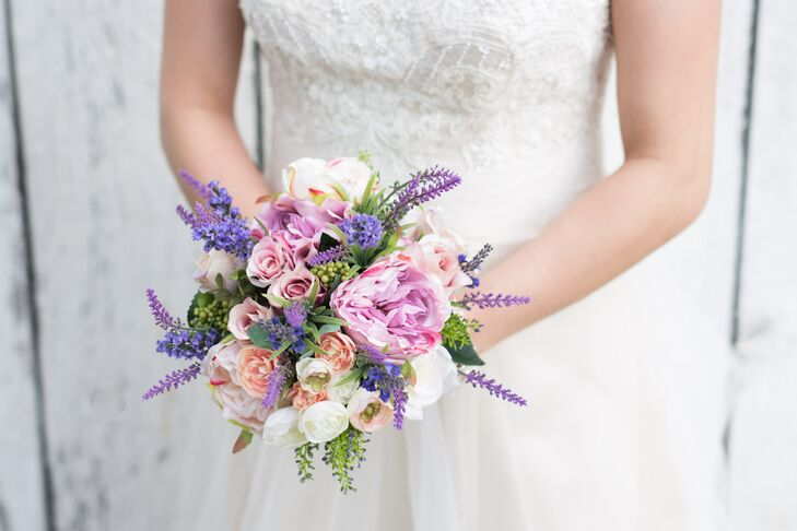 Heather carried a bouquet with blush roses, pink peonies, ivory ranunculus and lavender.