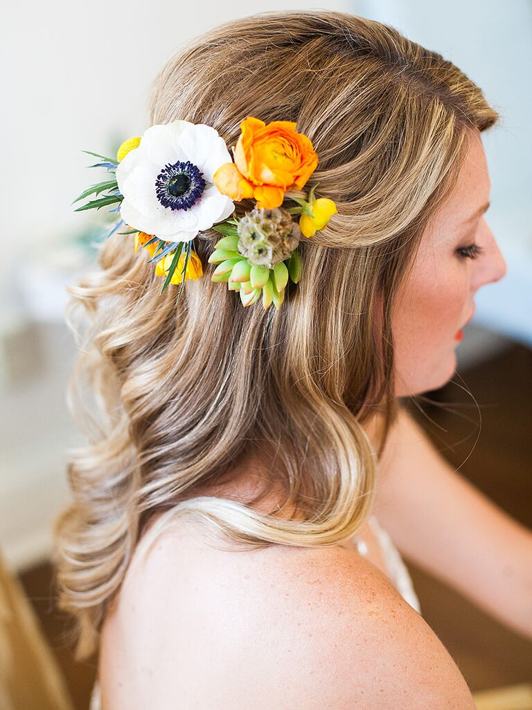 Wedding hairstyle with floral hair piece