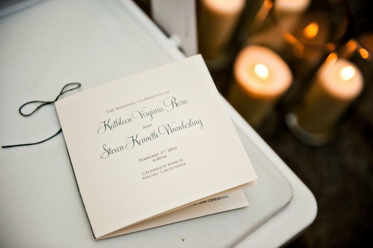 Katie and Steve chose a simple, formal style for their ceremony programs with ivory paper and classic script typeface.