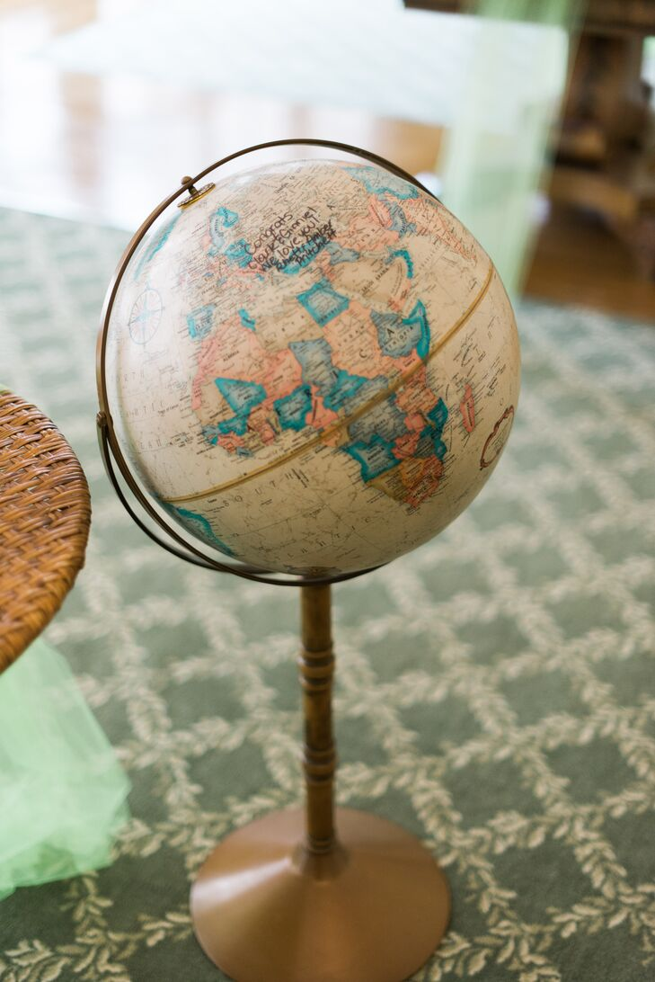 For their guest book, Ginnie and Tyler had their guests sign their names and notes on a decorative globe.