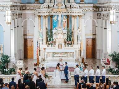 couple getting married in church