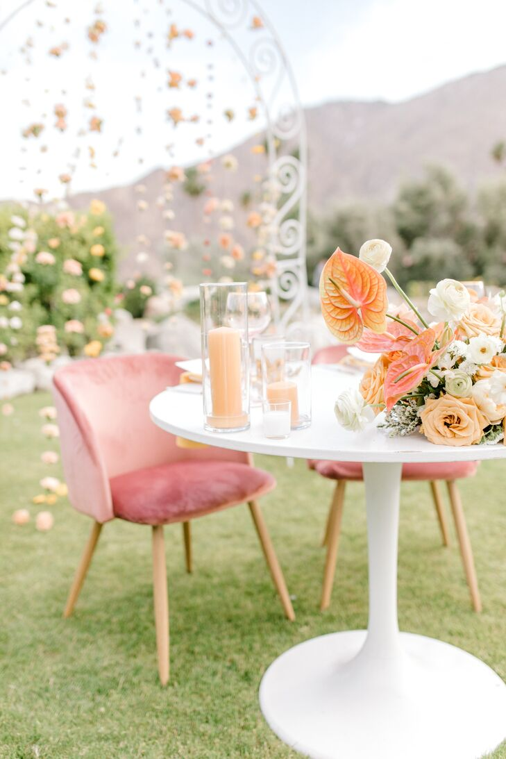 Whimsical Sweetheart Table with Pink Lounge Chairs and Candles