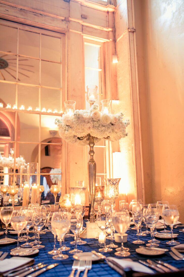 Elegant White Rose Centerpiece on Silver Candlestick