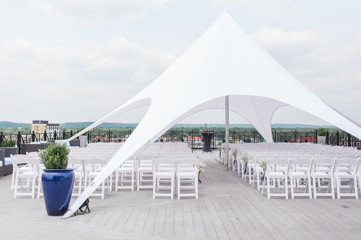 Amber and Adam were married atop SkyDeck, a rooftop bar in downtown Kalamazoo, Michigan. A seriously modern white tent tied the ceremony together.
