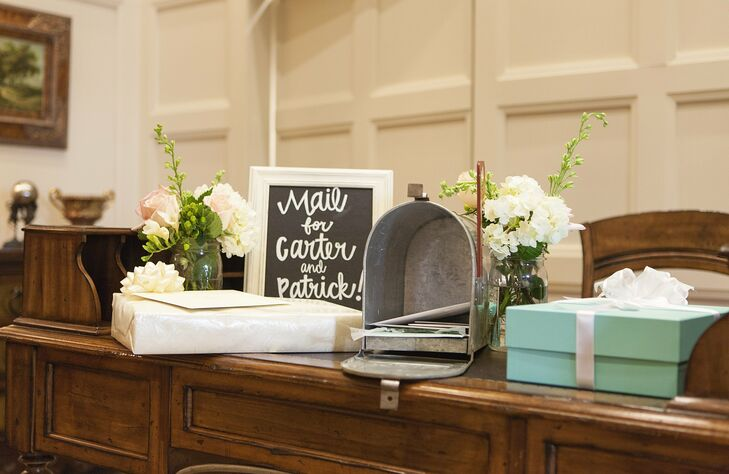 The couple set out a cute metal mailbox where guests could place cards and packages during the reception.