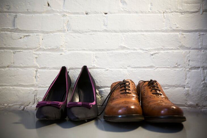 Nicky wore black heels rimmed with purple and Linsey wore a pair of brown dress shoes on the wedding day.