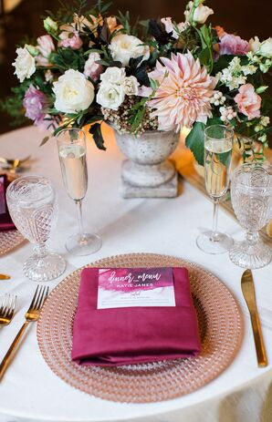 Purple Place Setting with Gold Flatware and Champagne Flutes