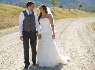 Ally and Danny held their mid-summer wedding at the Riverside Lodge in Garden Valley, Idaho surrounded by breathtaking views of the mountainous landsc