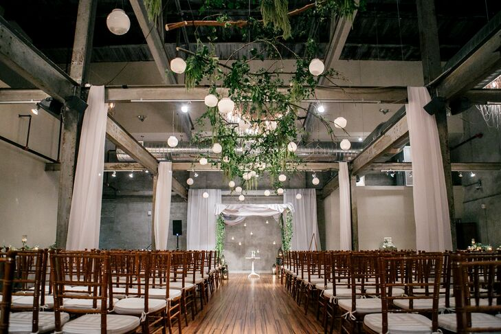 """With Samantha and Brian coming from Jewish and Catholic backgrounds, the two fused the two traditions to create an interfaith ceremony that was easily relatable for both of their families. """"We brought Jewish and Catholic customs together so that all our guests would feel that it was familiar and inclusive,"""" Samantha says."""