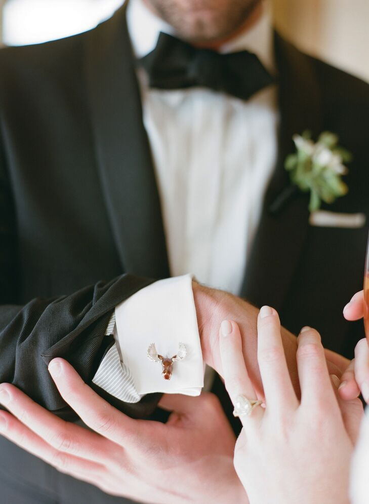 Cody wore a Burberry tuxedo with matching jacket,  suspenders and a real bow tie. But it was the pair of moose-head cuff links crafted by Deakin & Francis U.K. that Katie surprised him with that; it gave his look a little Wyoming western flair.