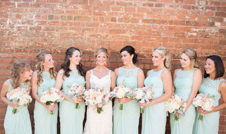 The bridesmaids wore mint, floor length, chiffon dresses that gathered in the back with a small train from David's Bridal.