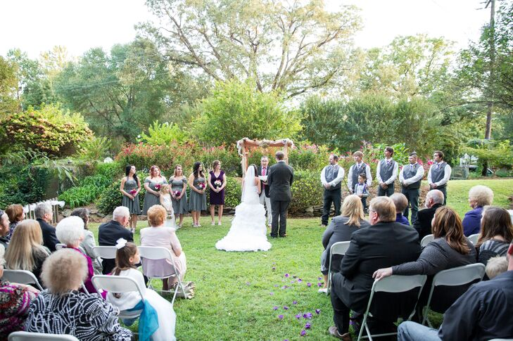 """""""When I get nervous I giggle, so I think I entertained our guests when I was trying to saw my vows!"""" says Britini."""