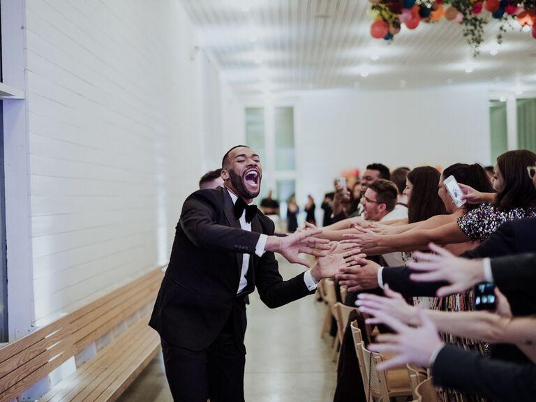 Groom wedding reception entrance