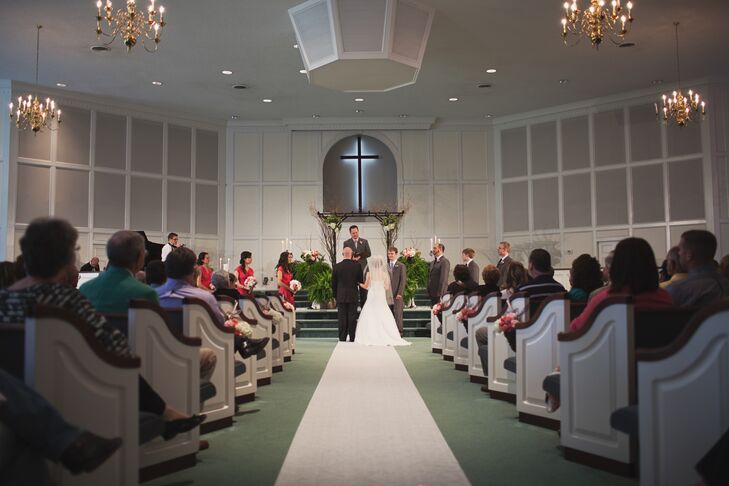 Emily and Alex exchanged vows at Mountain View Baptist Church  in Hickory, North Carolina. It was the church they grew up in, so it had a lot of meaning. They decorated the chapel with candelabras and ferns at the altar and pink roses on some of the pews.