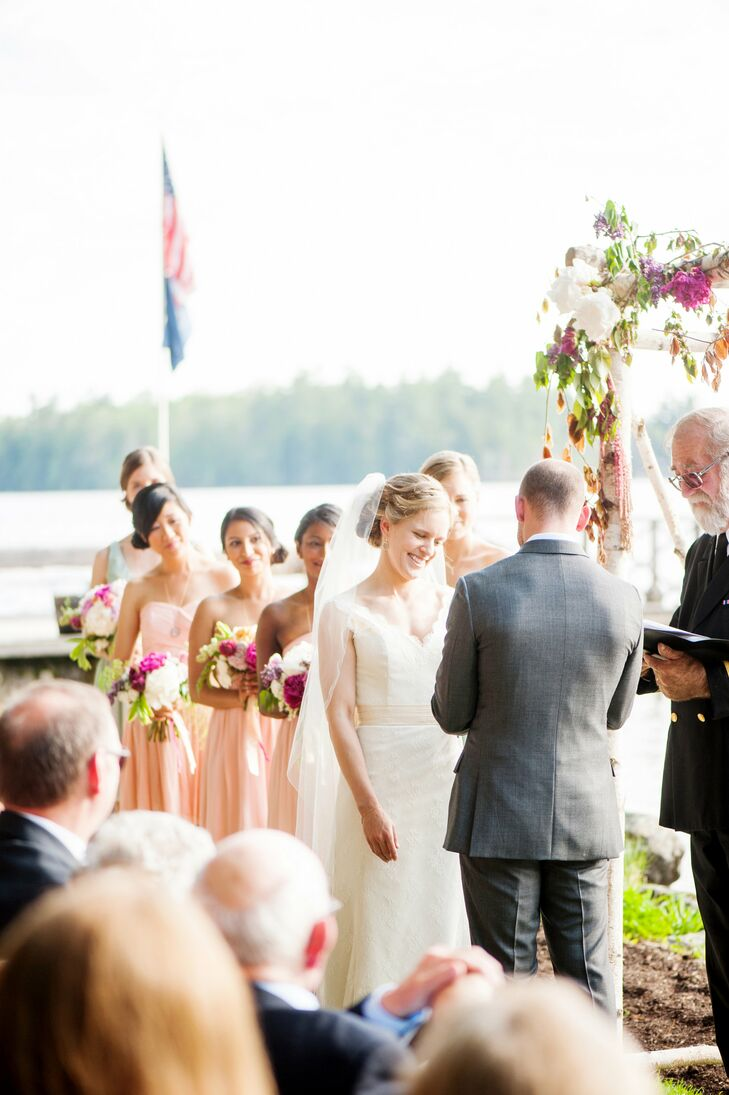 "The ceremony took place on the shores of Sebago Lake, the calm waters, surrounding pine forests and soft sunlight forming a striking backdrop for the occasion. The couple exchanged vows under a handcrafted birch chuppah, a nod to their Jewish heritage, and friends and family members read excerpts from Michelle and Matt's favorite childhood books, including ""The Velveteen Rabbit."" White wrought-iron cafe chairs added a vintage flair to the decor, while a rustic wooden board displaying the watercolor programs highlighted the natural setting. The band Search Party provided the sound track for the ceremony, playing renditions of the Beatles' ""Here Comes the Sun"" and ""In My Life,"" as well as the Turtles' ""Happy Together"" for the processional and recessional."