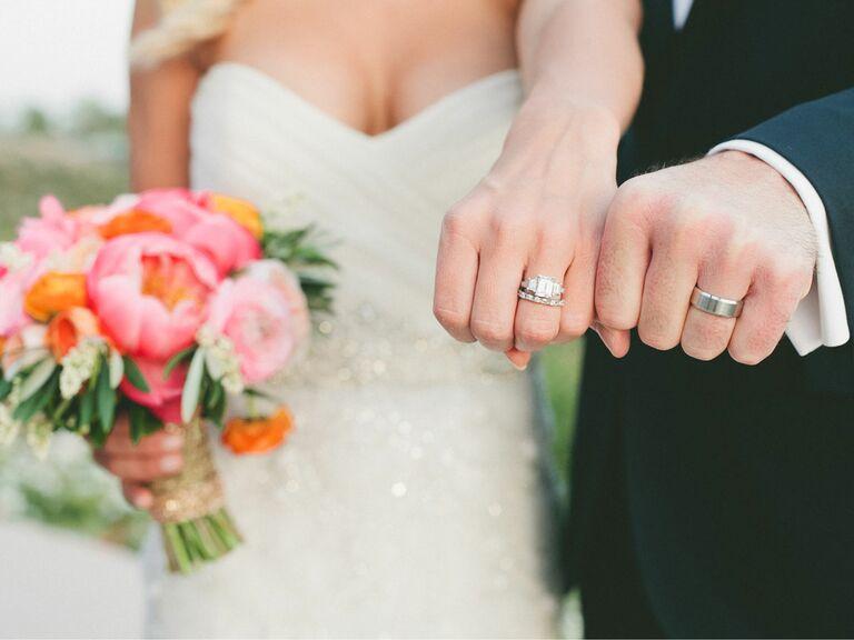 newlyweds showing wedding rings