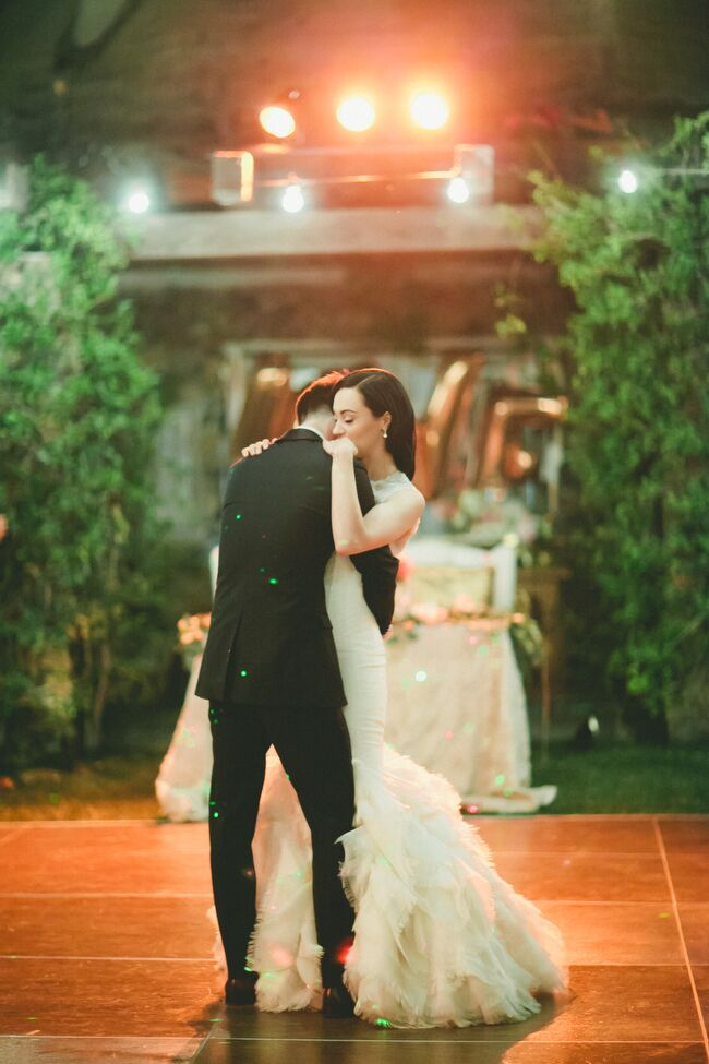 """After dinner and a few sweet treats, Sarah and Brendan took to the dance floor for the traditional first dance. """"One of my favorite memories from the party was Brendon serenading me with our song, 'Faithfully' by Journey, as we danced our first dance together as husband and wife,"""" Sarah says."""