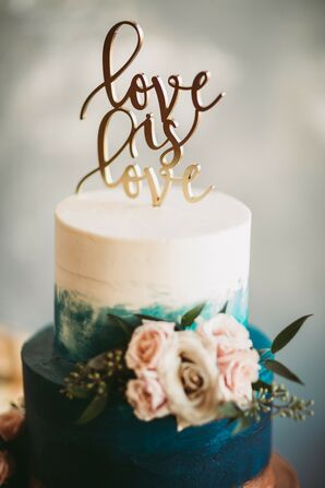 Modern Wedding Cake with Hand-Painted Blue Details and Gold Topper