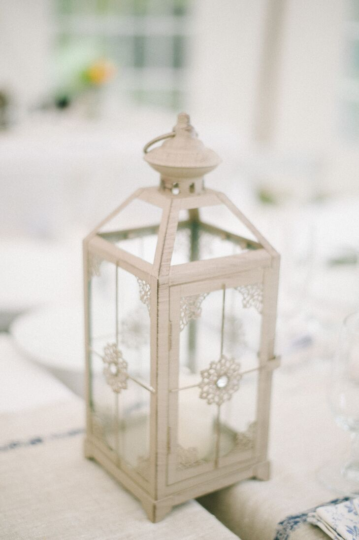Apart from romantic arrangements of peach flowers at the reception tables, centerpieces were also made of vintage-inspired lanterns and candles.