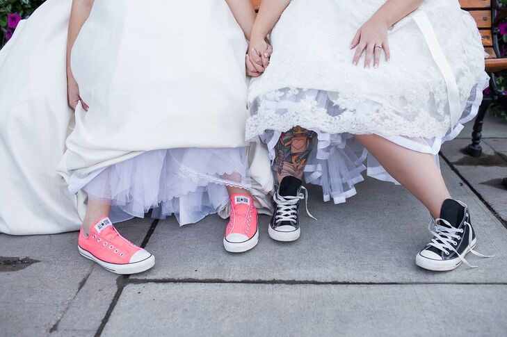 Nicole and Morgan wore pink and black Converse shoes, adding a whimsical touch to their bridal styles.