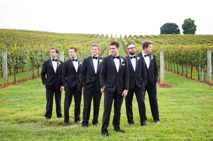Groom and groomsmen wore classic black tuxedos.