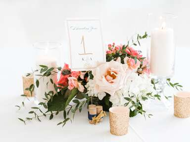 Wine cork table numbers with light pink and white flowers