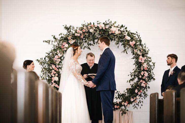 Indoor Wedding Ceremony with Rose Floral Wreath