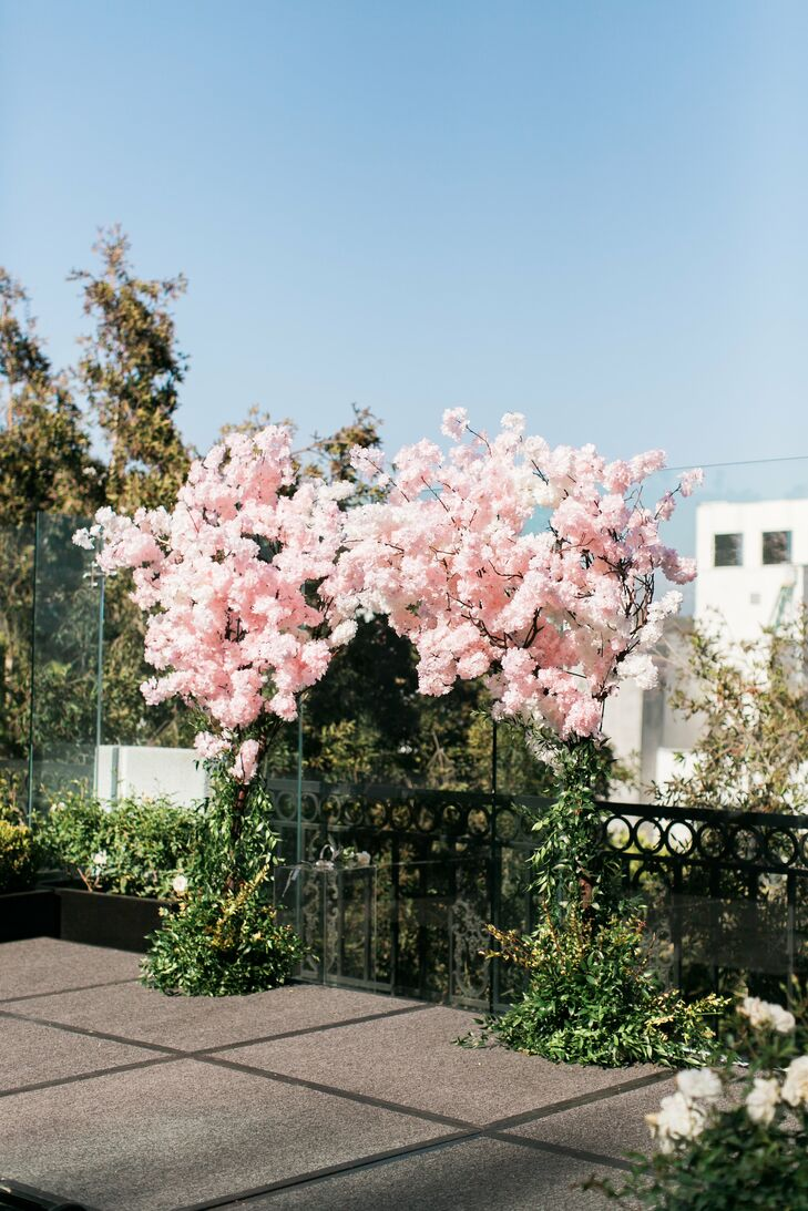 Rooftop Ceremony Arch with Cherry Blossoms and Greenery