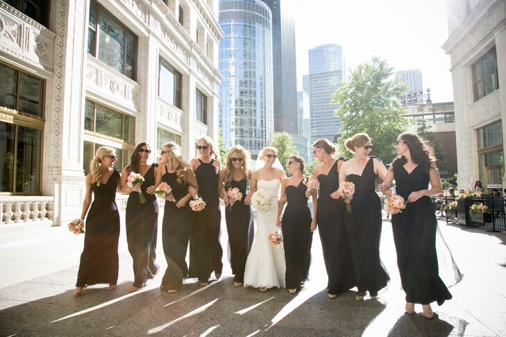 """Lisa's bridesmaids wore navy floor-length dresses with different Amsale necklines. """"I chose navy blue in honor of the Fourth of July and because it is one of my favorite colors,"""" Lisa says.  The bridesmaids carried pink garden rose bouquets with their dresses."""