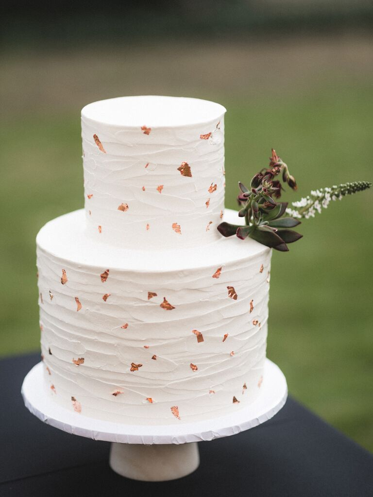 Simple white two-tier wedding cake with metallic flecks