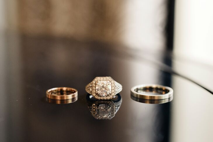 The couple chose simple brushed gold wedding bands to complement the sparkle of Britteny's vintage-inspired engagement ring.