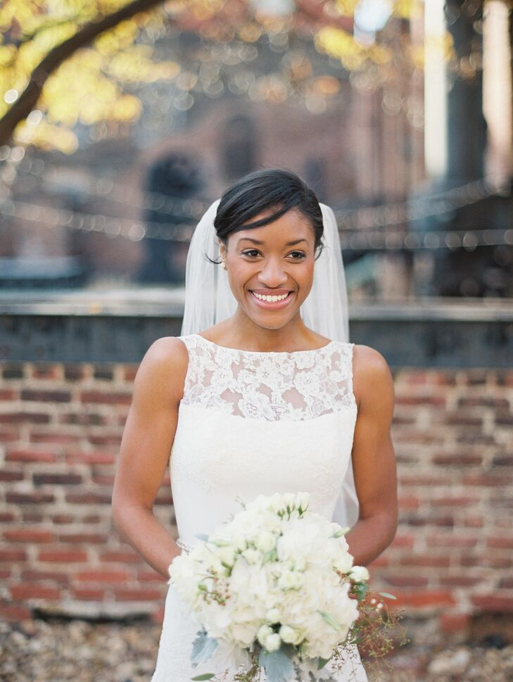Alexandria's A-line wedding dress from Bridal Elegance featured an illusion neckline in lace. She also wore an elbow length veil on her wedding day.