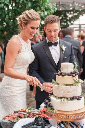 Couple Cutting into Cheese Wheel Cake