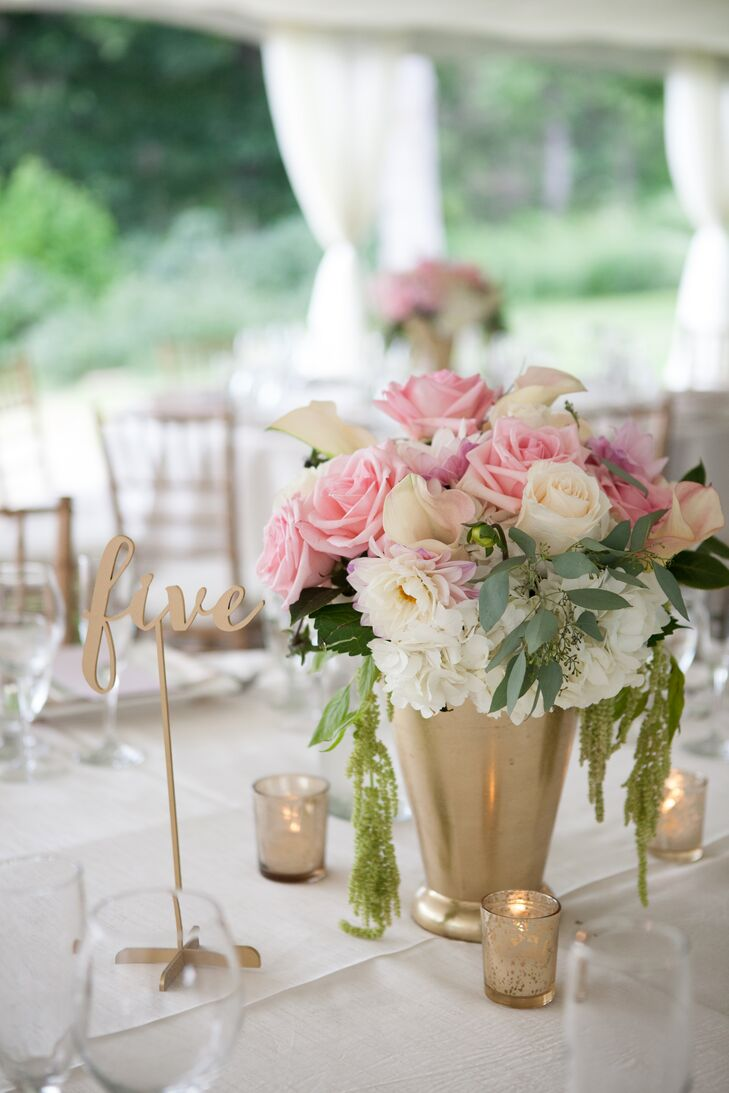 Pink And White Flower Arrangements In Gold Vases