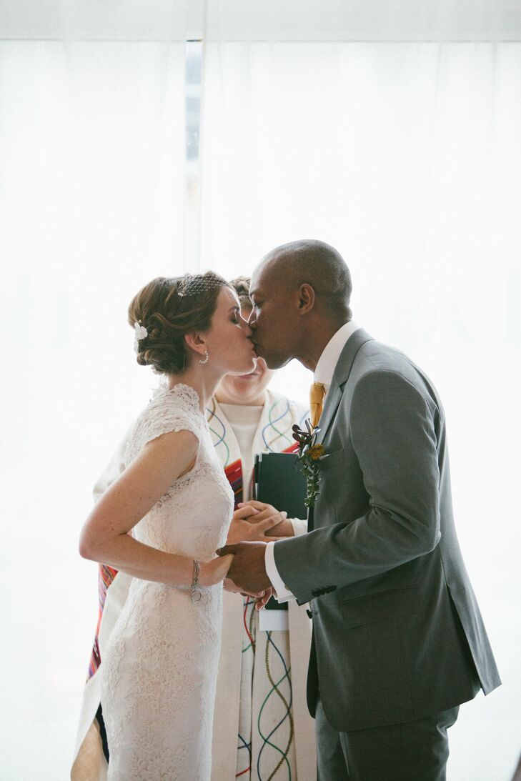 Debra wore a custom-made romantic lace gown with cap sleeves. Ben went with a gray suit and a yellow tie.