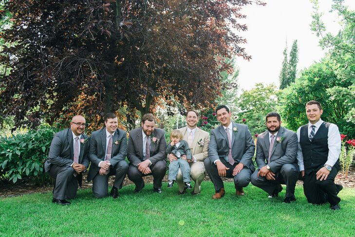 The groomsmen wore gray suits while Geoff wore a cream tuxedo with a pink tie.
