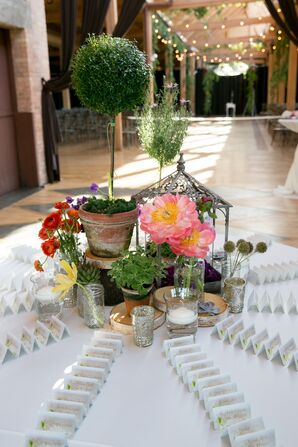 Escort Card Table With Succulent and Wildflower Centerpiece