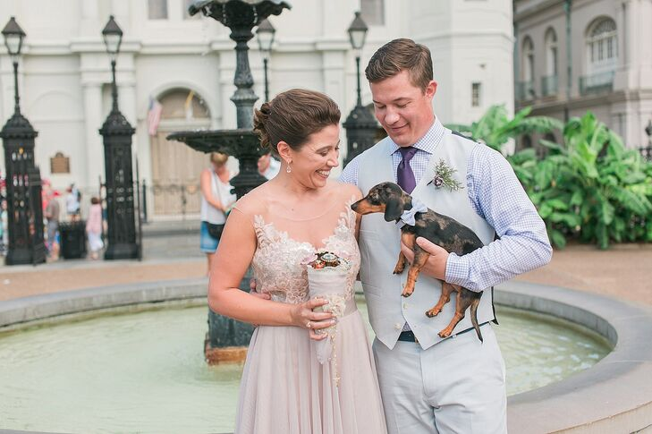 """Of course, their dog Huey, miniature dachshund, had to be involved in the day! After he was walked down the aisle by Amber's maid of honor, he joined Amber and Ty for a quick photo opp. Complementing Ty's shirt, he wore a blue searsucker bow tie. """"He was really the star of the show!"""" says Amber."""