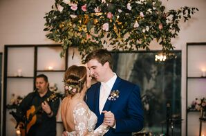 Romantic First Dance Under Hanging Flowers
