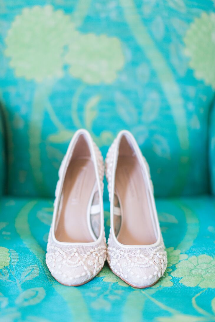 To complete her elegant, romantic wedding look, Kristina paired these lacy heels with her strapless Vera Wang gown.