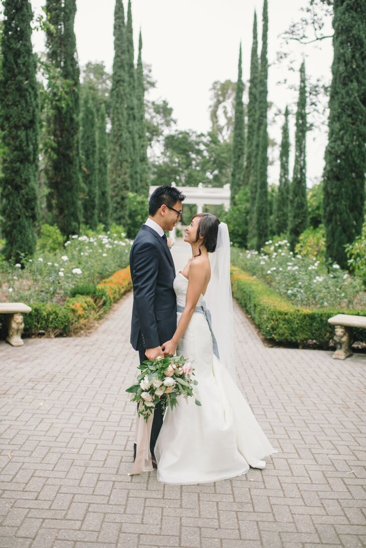 """Jauchy wore an ivory mermaid-style gown by Alyne. """"It's made of silk organza, which made it incredibly light and easy to wear. The second I put it on, I felt like I was floating,"""" Jauchy says. Jeff donned a three-piece navy suit by J.Crew."""