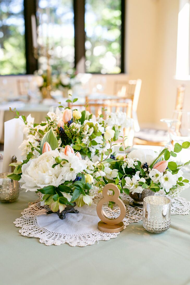 Reception Tables Were Decorated With Loose Blush And Ivory Flower Arrangements Numbered Gold Art