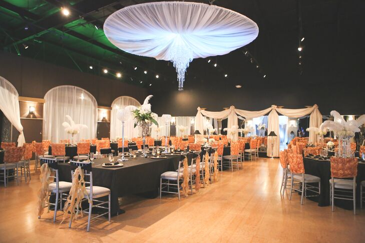 """Instead of focusing on flowers, Jana and Caleb opted to add a dramatic pop with white feathers and hanging crystals. """"We had black table clothes with sparkly gold table runners and vintage ruffled gold chair covers,"""" says Jana. """"The rooms even had Tiffany blue uplighting to accent our overall decor."""""""