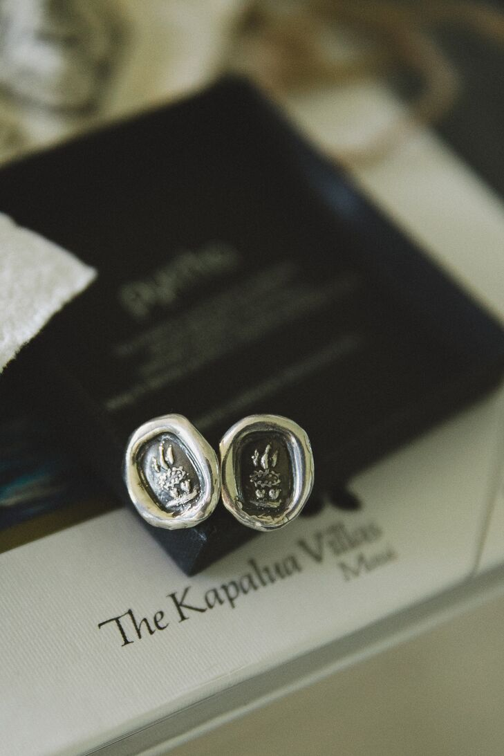As a wedding gift, Tara had custom Pyrrha cufflinks made for Matthew, which he wore with his navy suit and blue gingham shirt.