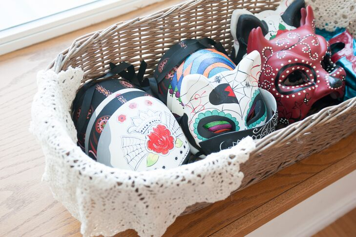 The couple gave their guests Dia de los Muertos masks as wedding favors.