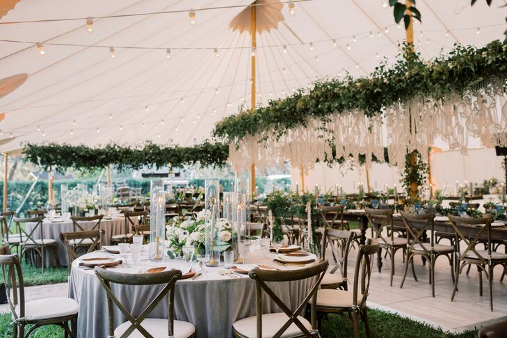 Tented Reception with String Lights, Hanging Greenery and Dining Tables