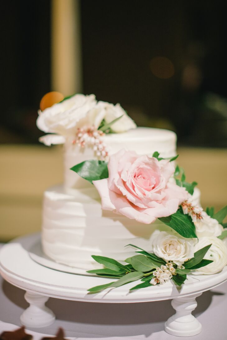 Satura Cakes crafted the couple's wedding cake, a two-­tier strawberry shortcake adorned with fresh flowers. Guests indulged in a full dessert bar, which featured a variety of mini­cakes, from red velvet to green tea and carrot cake.