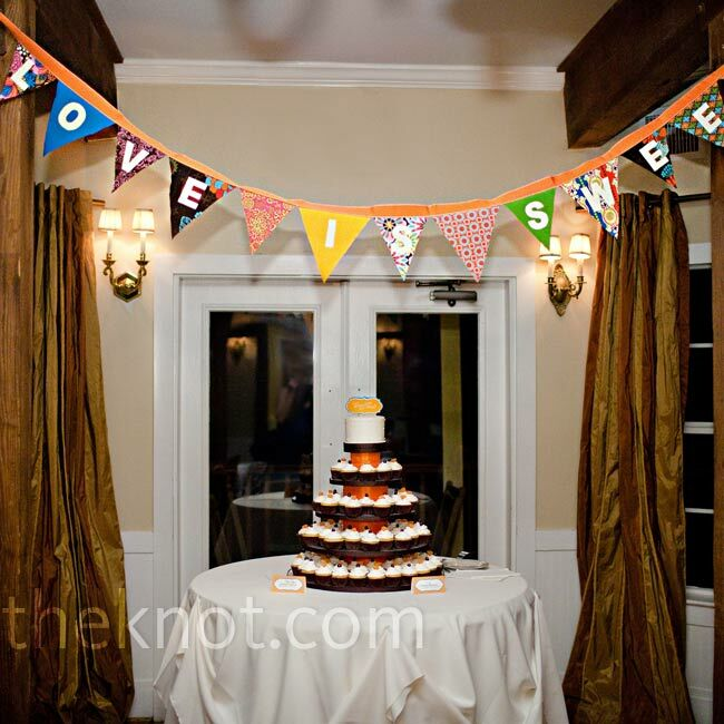 A fabric banner hung above the cupcake tower.