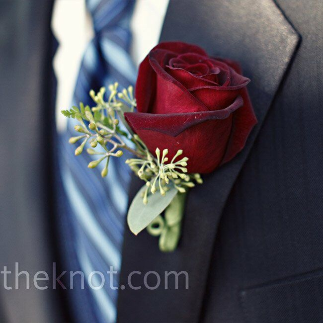 The groomsmen wore roses with seeded eucalyptus on their lapels to match the bridesmaid bouquets.